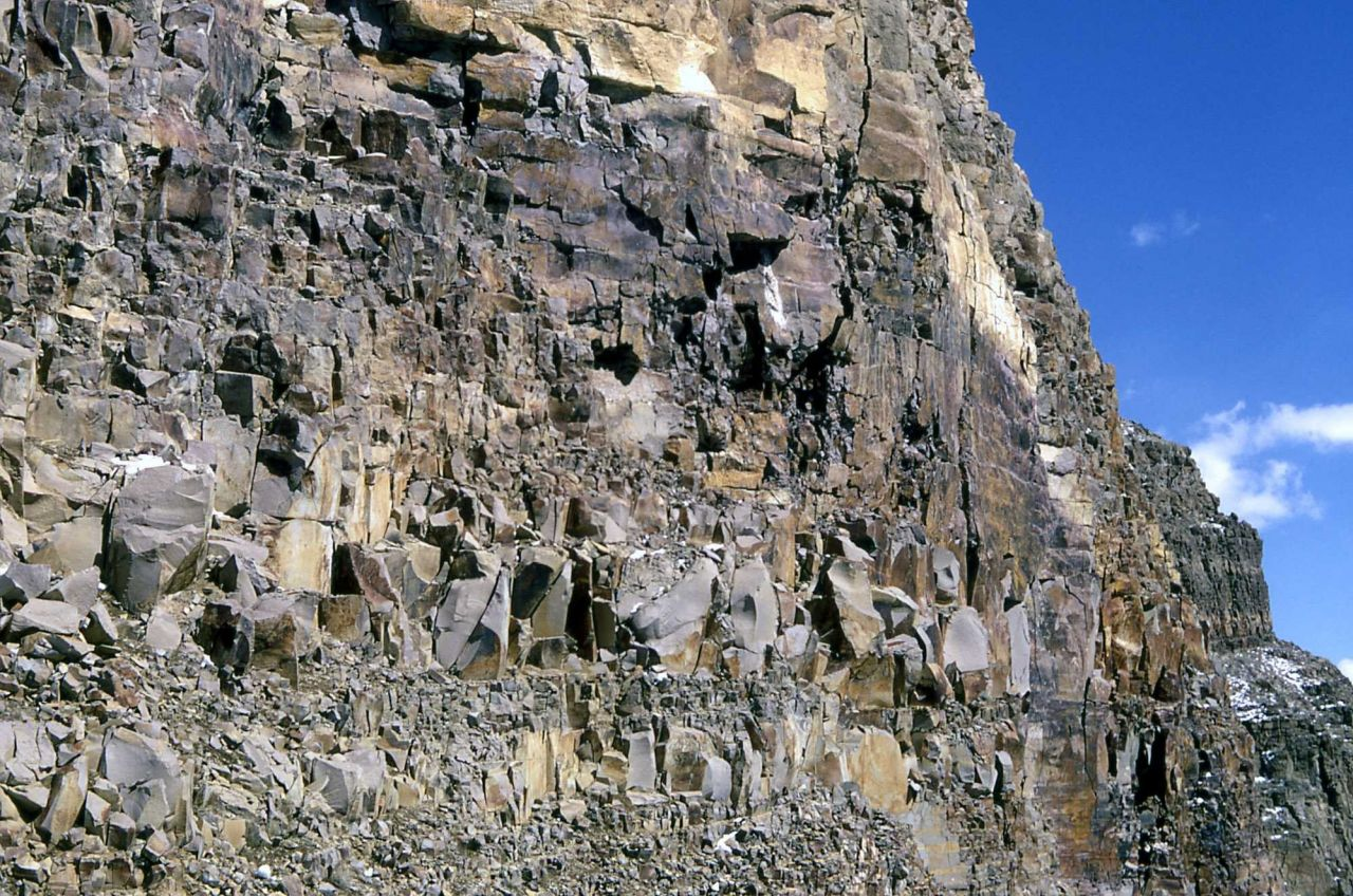 Cliff face of angularly fractured Yellowstone Tuff Photo