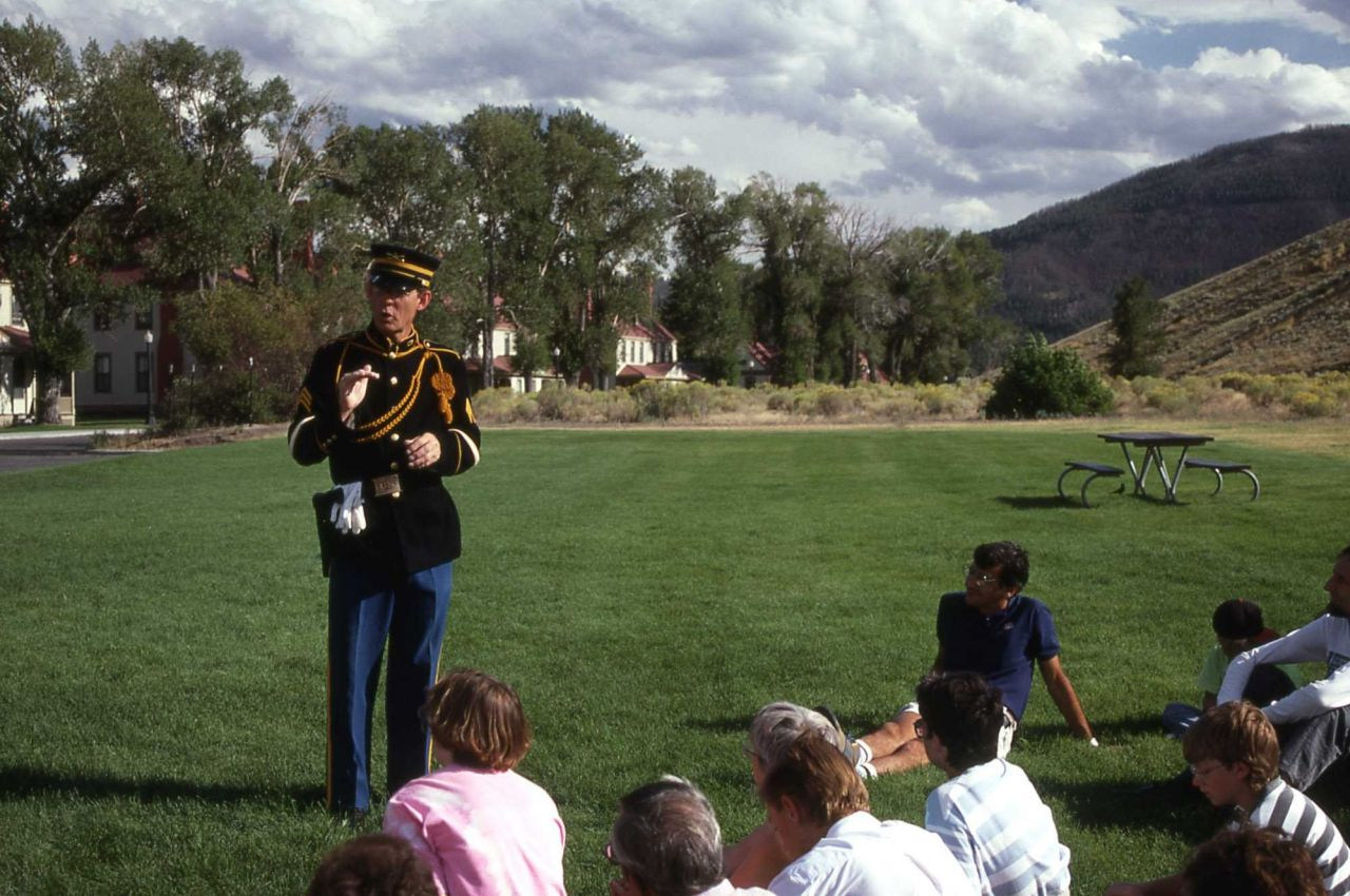 John Whitman, in a soldiers uniform, leading a Fort Yellowstone walk Photo