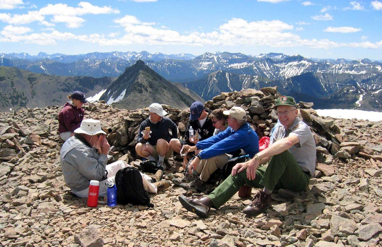Ranger Harlan Kredit with group on Avalanche Peak fee hike Photo