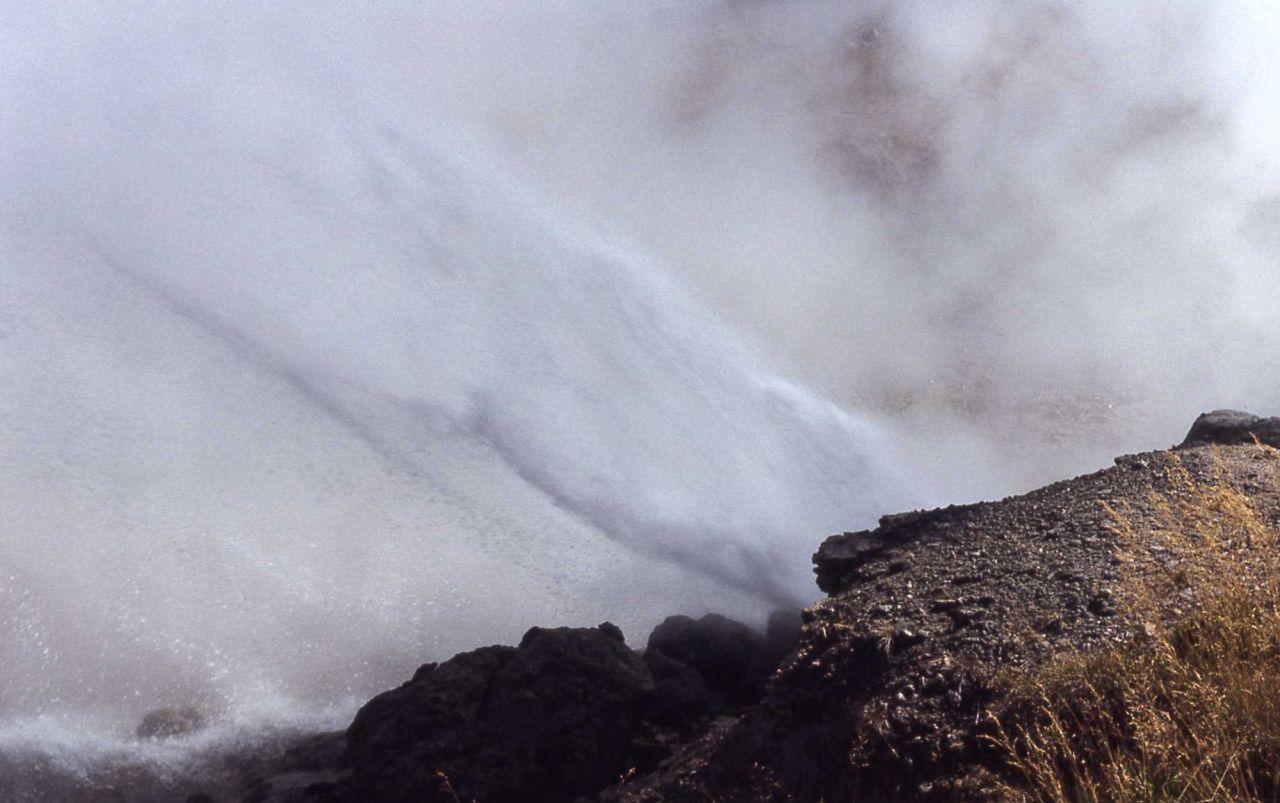 Ledge Geyser erupting - Norris Geyser Basin Photo