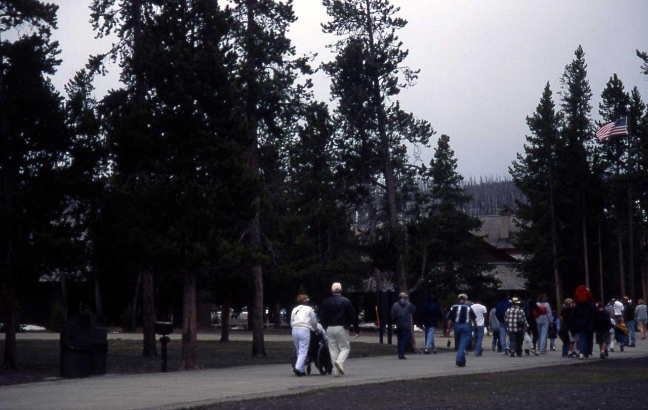 Visitors leaving Old Faithful Geyser after eruption Photo
