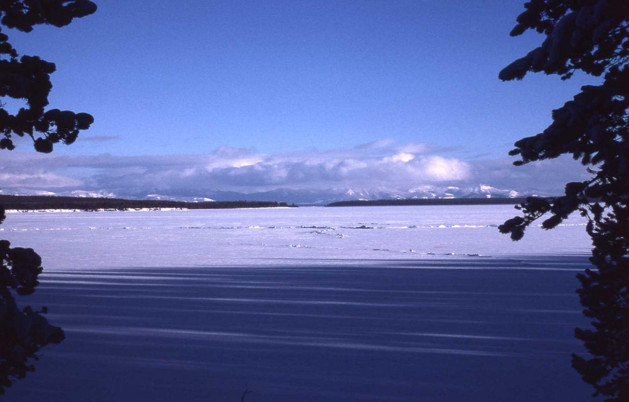 Yellowstone Lake frozen in the winter Photo