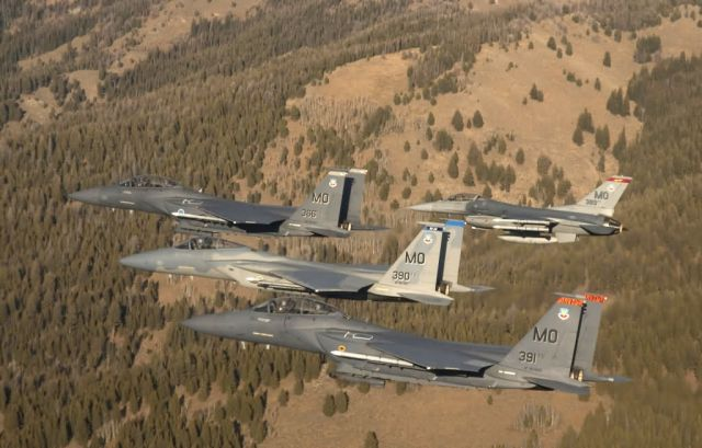 Two F-15 Strike Eagles, an F-15 Eagle and an F-16 Fighting Falcon - A Four-ship formation - Mountain Home Air Force Base - Flying over Idaho Picture