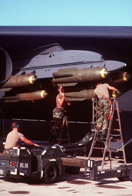 MJ-1 bomb loader - Ordnancemen load bombs on a B-52 Stratofortress aircraft Picture