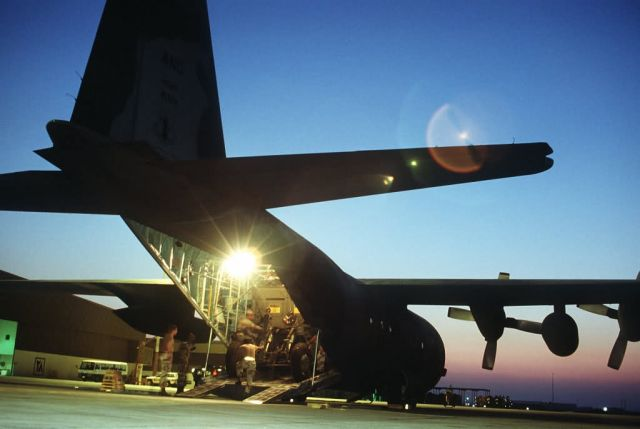 C-130 Hercules transport aircraft being loaded Picture