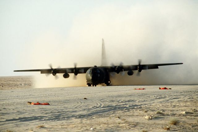 C-130E Hercules transport aircraft - C-130E Hercules does an assault landing Picture