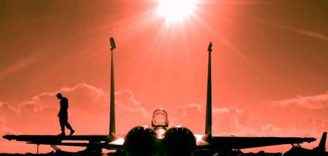 F-15 fighter - Silhouette of a crew chief walking on the wing of an F-15 Picture