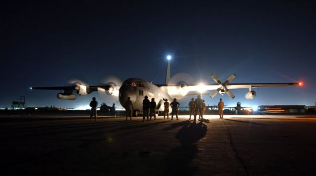 EC-130 - Troops look up to EC-130 support Picture