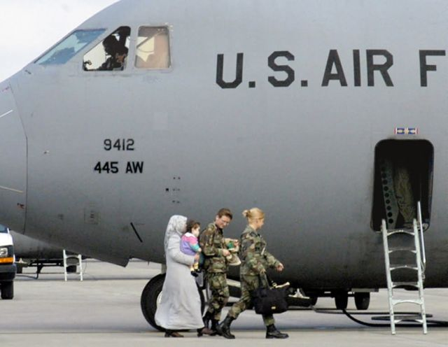 C-141 - Airmen fly Iraqi baby home Picture
