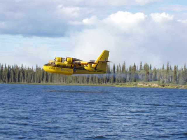 Waterbomber CL-215 scoops water Picture
