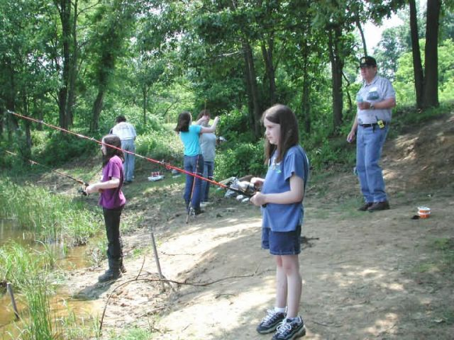 Young girls, parents, and volunteers,fishing at Occoquan Bay NWR Picture