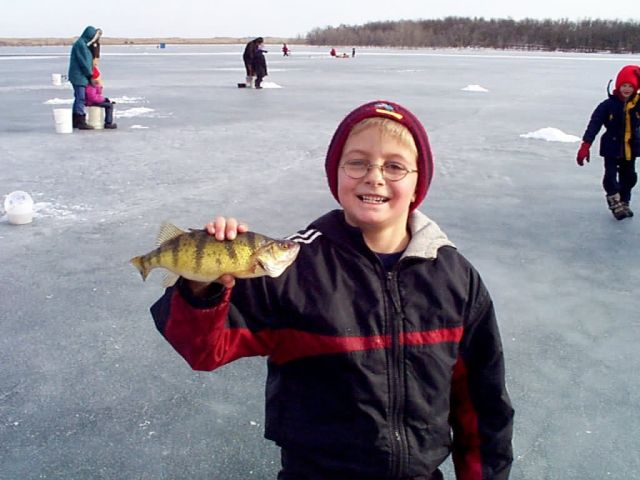 Boy with fish, Waubay National Wildlife Refuge Picture