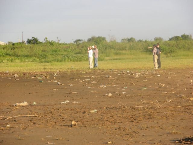 Bird Watching in Asuncion Wetland Amongst Trash Picture