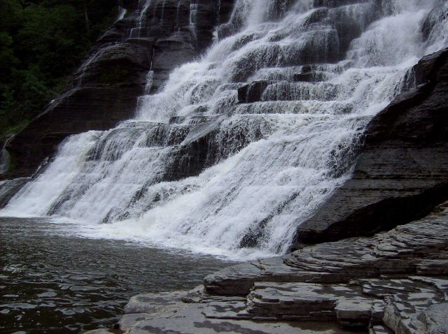 Bubbling, babbling waterfall dropping over shale formations which have eroded in stepping-stone fashion. Picture