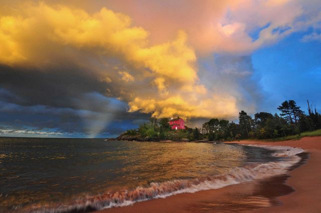 Marquette Lighthouse at sunset with thunderstorm clouds at sunset. Picture