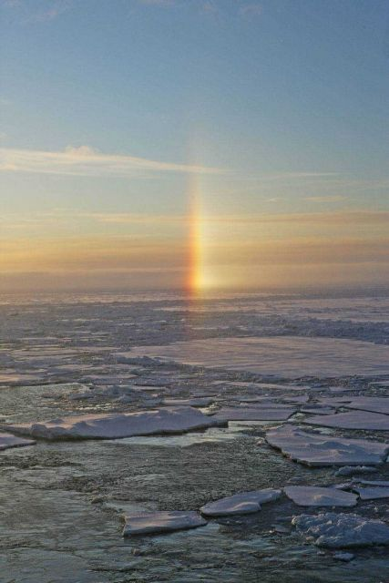 A sun dog - an atmosphere phenomenom caused by refraction of sunlight through ice crystals in the atmosphere Picture