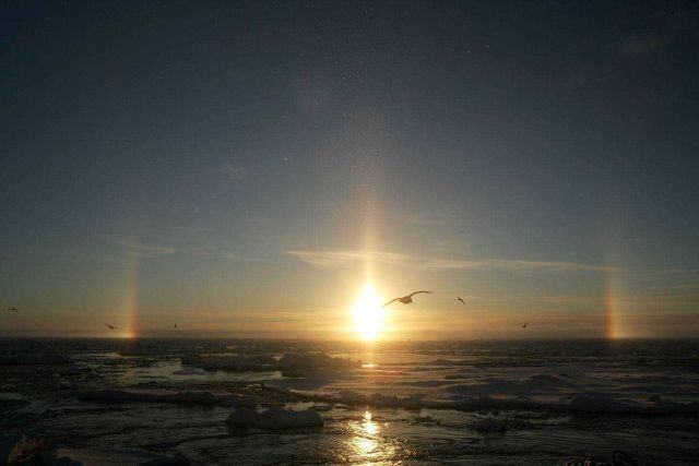 Sun dogs and pillar - atmosphere phenomenom caused by refraction of sunlight through ice crystals in the atmosphere Picture