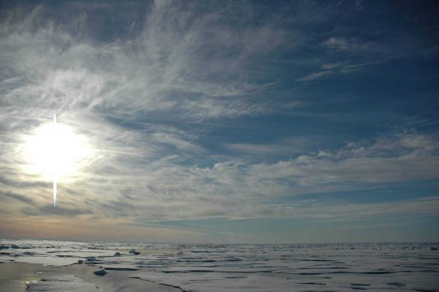 Midnight sun, melting Arctic ice, open leads, and cirrus clouds. Picture