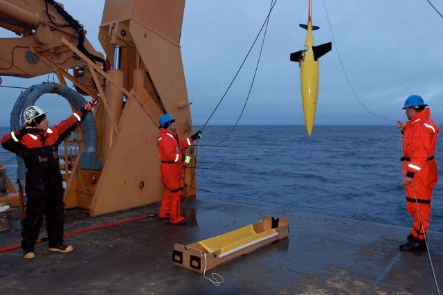 Deploying an instrument package from the stern of the USCGC HEALY Picture