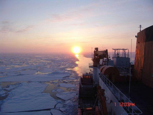 CGC HEALY passing through an area of first year ice floes with the sun directly astern. Picture