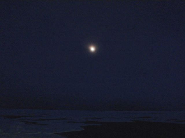 Moon and ice floes seen in an Arctic night. Picture