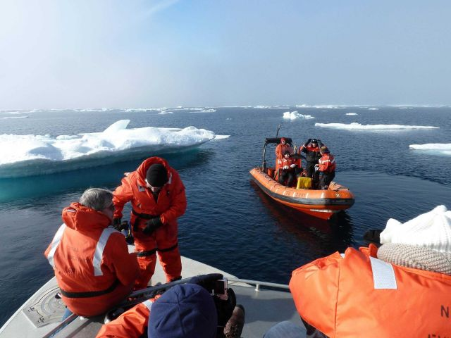 NOAA ship FAIRWEATHER boats among ice floes. Picture