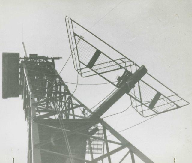 Shoran antenna secured on radar antenna. Picture