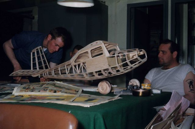 Model airplane under construction in the Petty Officers' lounge on the PATHFINDER. Picture