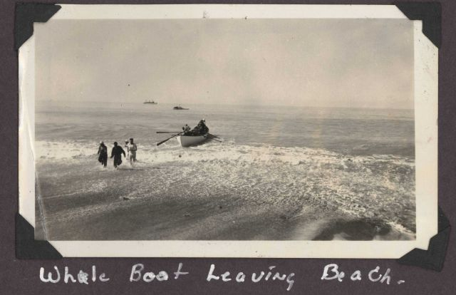 Whale boat leaving beach. Picture
