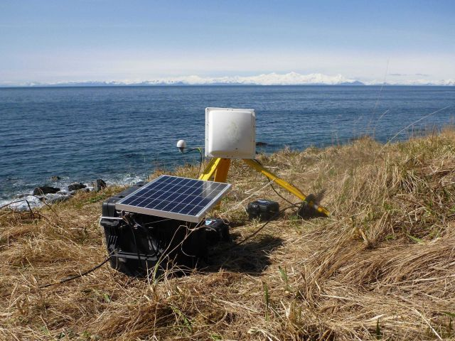 GOES satellite antenna and solar panel used in transmitting tidal data to satellite and thence to processing center. Picture