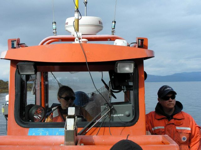 Small boat with Trimble GPS receiver being used for shoreline mapping and aerial photography editing. Picture