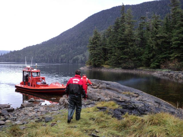 RHIB (rigid hull inflatable boat) picking up shore work crew. Picture