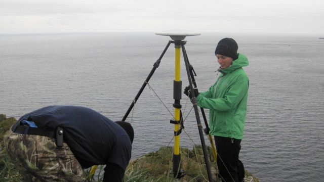 Securing GPS satellite receiver unit on a windswept promontory. Picture