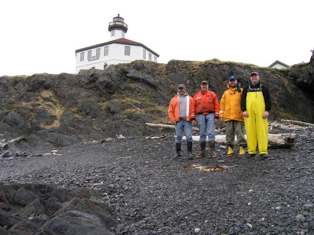 Archaeological crew on Eldred Rock with the lighthouse in the background Picture