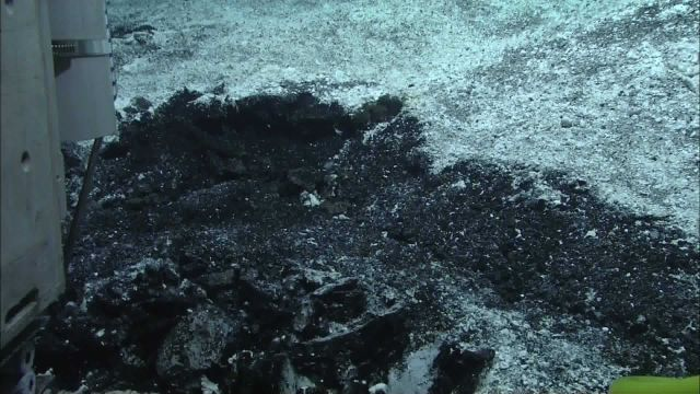 Sulfur-rich layer coating lava ash at Volcano O. Picture