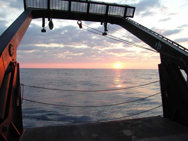 Sunset framed in the A-Frame of the NOAA Ship NANCY FOSTER Picture