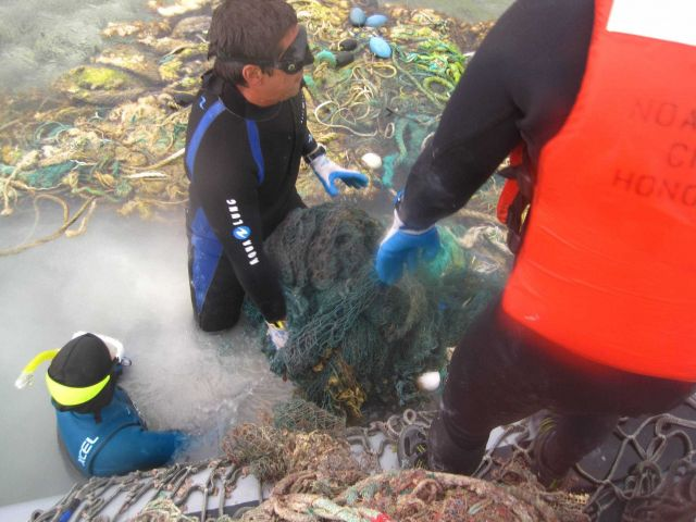 NOAA collected nearly 50 metric tons of amrine debris, which threatens monk seals, sea turtles, and other marine life in the coral reef ecosystem in t Picture