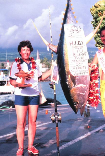 Angler standing next to 170 pound Yellowfin tuna caught during Hawaiian International Billfish Tournament. Picture