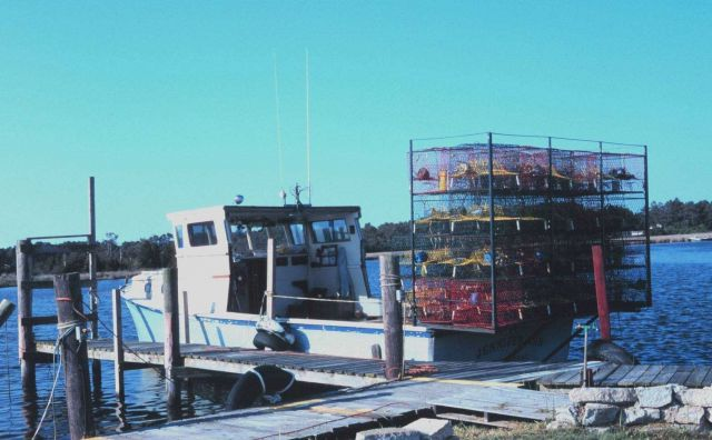 A blue crab fishing boat loaded with pots and ready to go to work. Picture