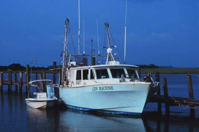 Humor in names - the F/V LIEN MACHINE tied up at Crosby's Fish & Shrimp Co. Picture