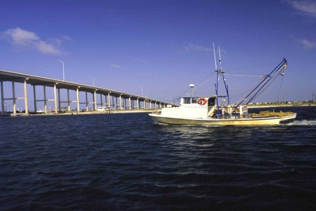 A small Texas shrimp boat heads out of Corpus Christi for day-long fishing trip in the productive Laguna Madre. Picture