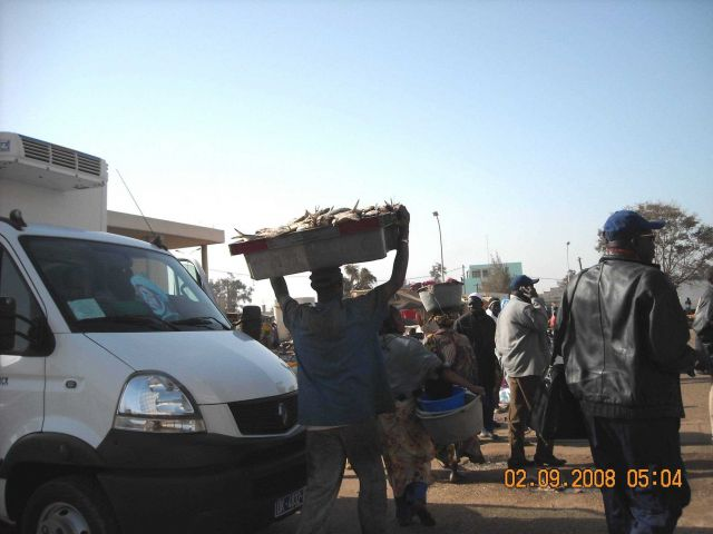 Carrying fish to the market place in Dakar. Picture