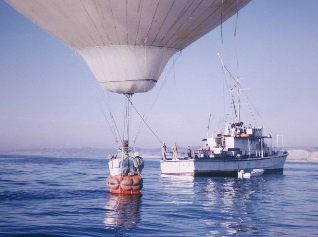 The YAQUI QUEEN, off La Jolla, either rescuing a downed hot air balloon or engaged in a bizarre attempt to use a balloon for observation purposes. Picture