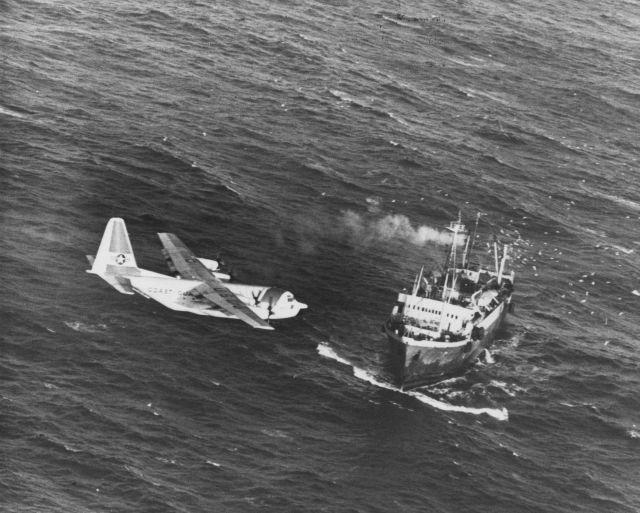 United States Coast Guard C-130 patrol aircraft passing over Soviet stern trawler. Picture