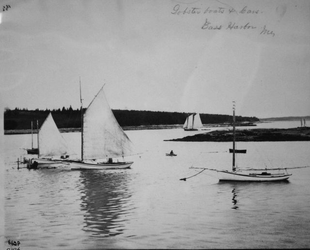 Lobster boats and cars, Bass Harbor, ME. Picture