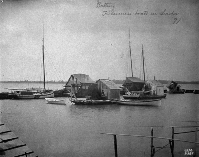 At Fishing Battery Hatchery and Lighthouse, fishermen's boats in harbor, 1891. Picture