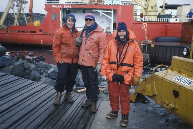 Polly Penhale (NSF), Rennie Holt and AMLR scientists at Palmer Station with R/V Polar Duke in background. Picture