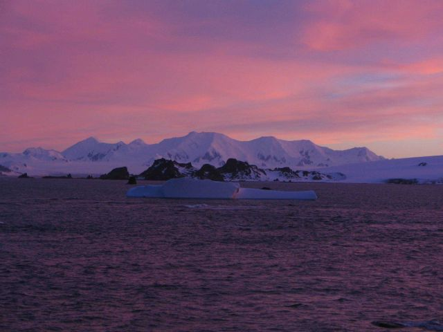 Sunrise over an Antarctic mountain range. Picture