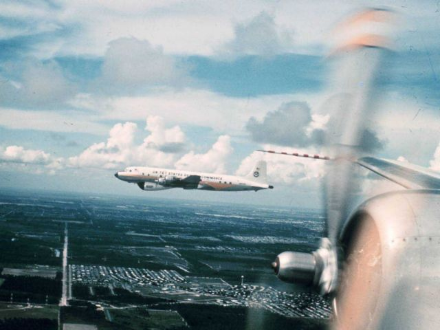 Weather Bureau DC-6 N6540C in flight as seen from DC-6 N6539C Picture