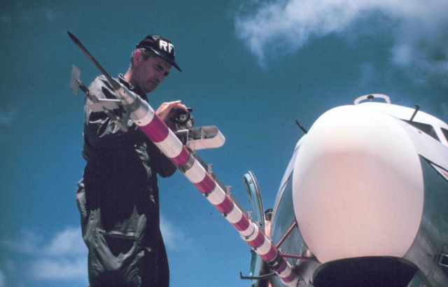 39C - McGavin working on gust probe and microwave refractometer. Picture